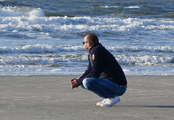 man thoughtful by sea