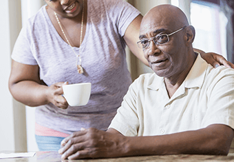 elderly man with wife or carer and cup of tea