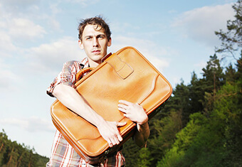 anxious man with suitcase,abroad,foreign,power of attorney