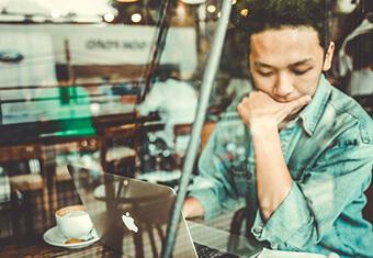 man thinking, using laptop