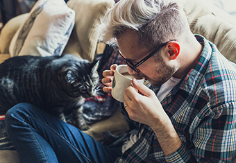 young man with cat