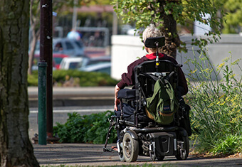 young person on motorized wheelchair