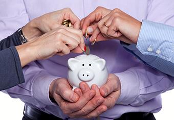 donating to charity - giving money - piggybank