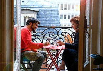 Couple on Paris balcony