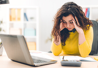 worried woman at computer