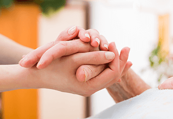 clasping hand of ill person hospital hospice